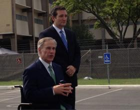 Greg Abbott (left) and U.S. Sen. Ted Cruz toured the Lackland facilities holding unaccompanied minors on June 23.