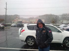 CPS crew members like Eric Fassett worked through light flurries of snow as a new storm hits the East Coast.