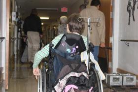 Resident of San Antonio State-Supported Living Center makes way down hall
