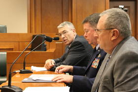 DPS Director Col. Steve McCraw (at far end of table, speaking) addresses the select committee.
