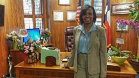 Mayor Ivy Taylor stands in front of her desk inside her new office at City Hall. In her first major move, she announced the city council will ask staff to draft an ordinance to remove the city's $32 million contribution to the streetcar project.