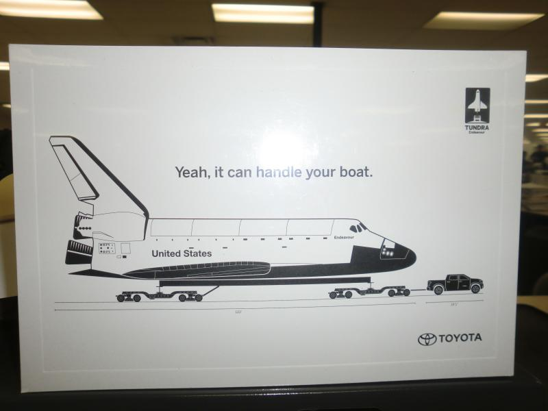 Toyota team members in San Antonio handed out postcards to commemorate the Tundra pull of Space Shuttle Endeavor.