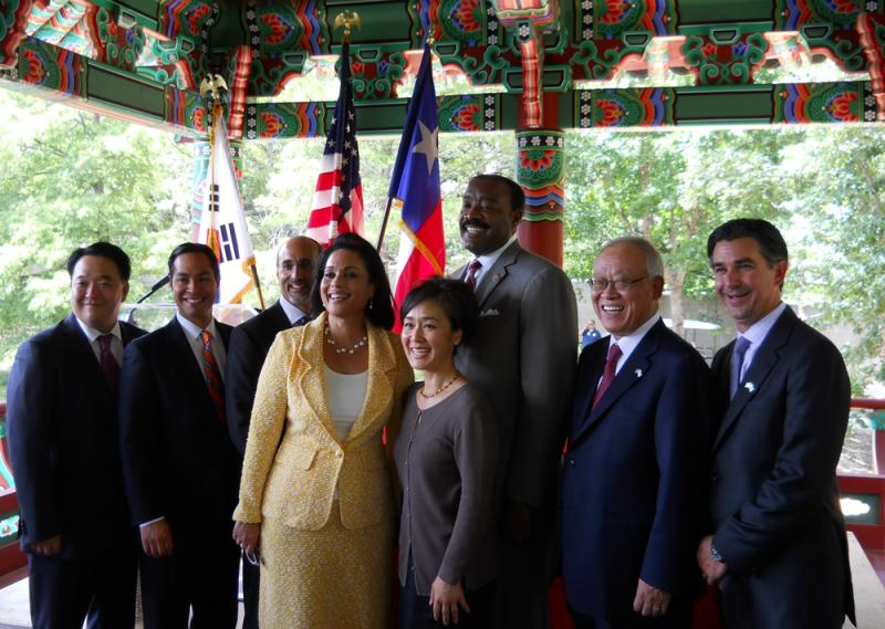 Officials from San Antonio and OCI Solar gather for a group photo at the announcement in July of this year. San Antonio used the Korean Pavilion at Denman Estates Park to highlight the Korean solar company's agreement with CPS.