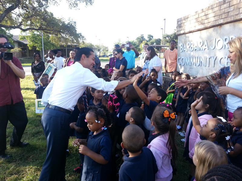 Following rally on Pre-K 4 SA, Mayor Julian Castro high-fives four year olds from the George Gervin Academy