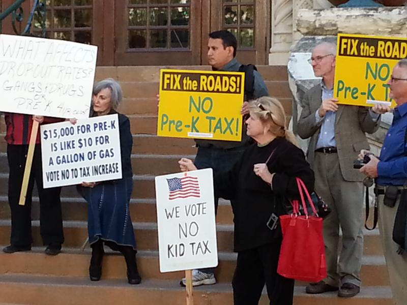 People held signs in protest of Pre-K 4 SA outside City Hall