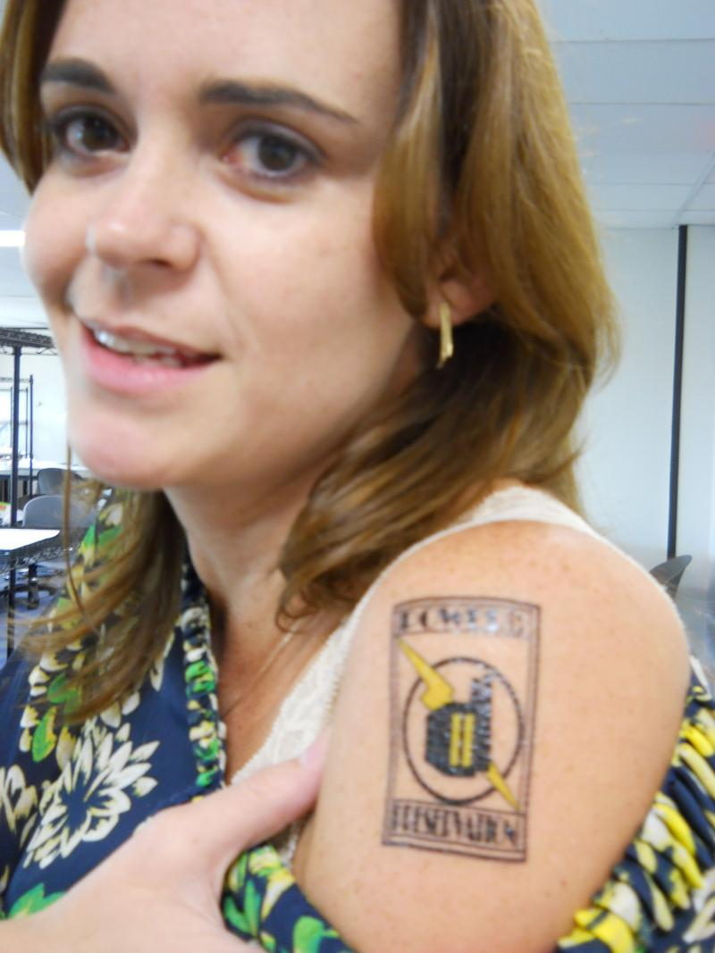 Shanon Peterson of the San Antonio Office of Historic Preservation showing off her Power of Preservation tattoo.