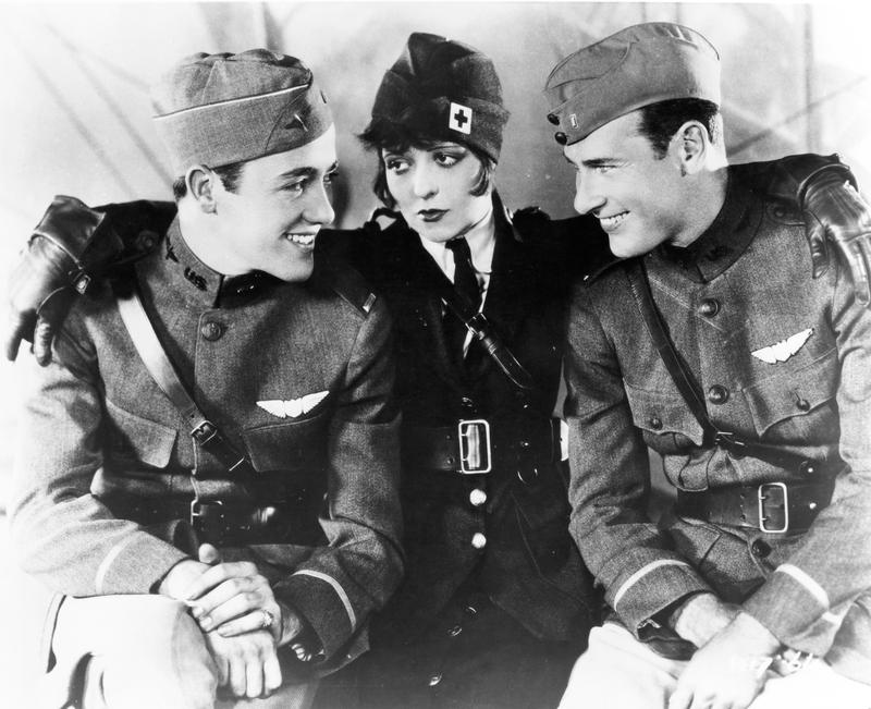 "Left to right: Charles ""Buddy"" Rogers, Clara Bow, and Richard Arlen on the set of ""Wings."""