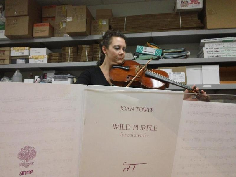 Eliza Thomason plays Wild Purple by Joan Tower in the Texas Public Radio mail room.