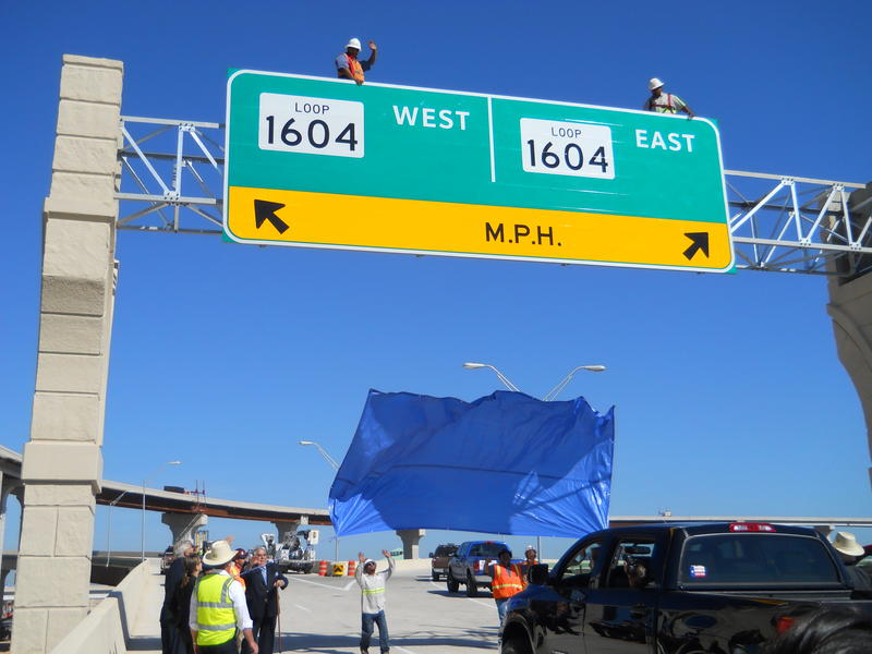 The 1604 East & West is unveiled by construction workers. Since construction began 18 months ago nearly one million man hours have gone into the project.