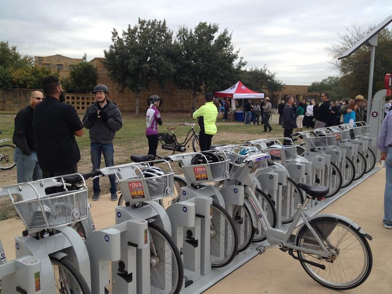 Cyclists wait near the new B-Cycle station outside of the Mission San Jose Visitors Center