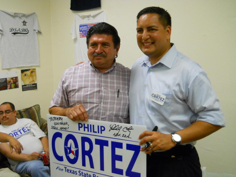 Philip Cortez (right) poses for a photo with voter Jerry Gonzalez.