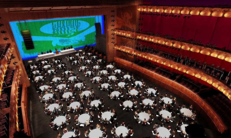 Theater seating can be lowered into the ground to create flat floor for receptions and galas.