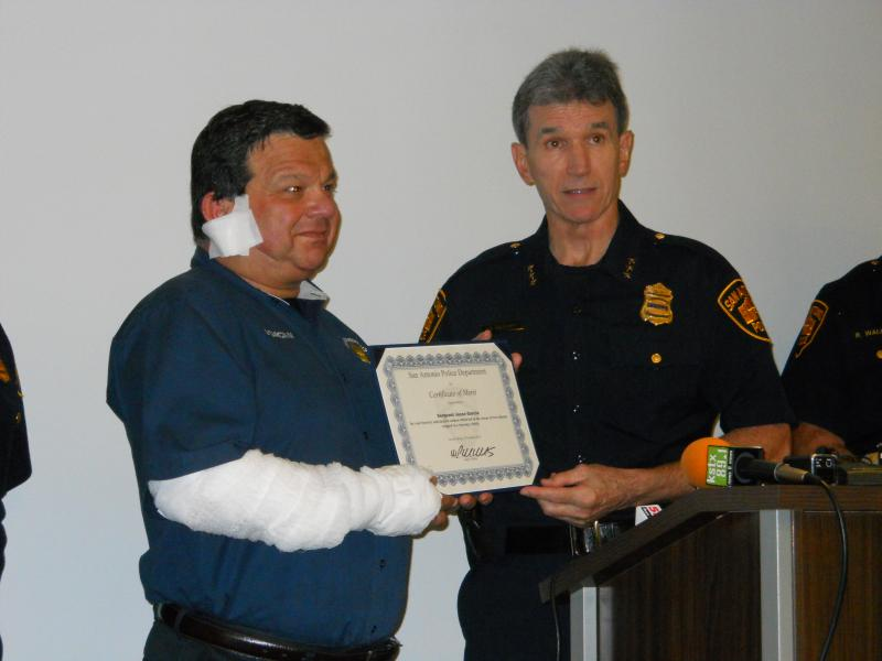 Sgt. Jesse Garcia recieves a Certificate of Merit from SAPD Chief William McManus on Monday for his actions early Saturday morning.