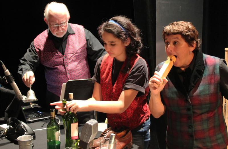Rick Malone (left), Molly Martinez-Collins (center), and Felice Garcia, handle objects to create the sound of the play.