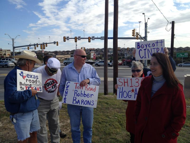 Anti-toll activist Terri Hall (far right) stands with protesters on the city's North Side.