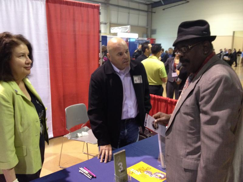 A veteran talks to an employer during the Red, White and You job fair held by the Texas Workforce Commission.