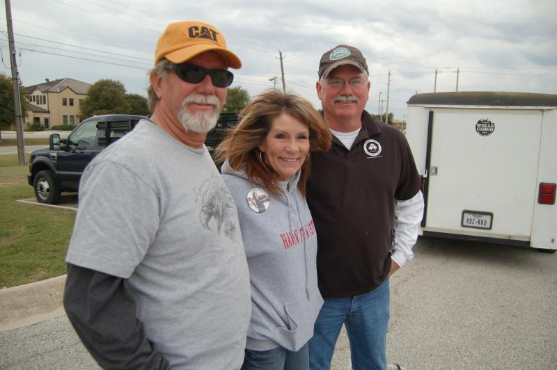 Maurice Johnson, Sandi and Owen Carlson near trailer where 600 blankets barely squeezed in