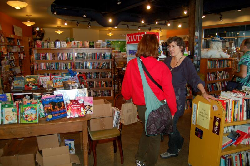 The Twig Book Store manager Claudia Maceo talks to customers during a busy Saturday