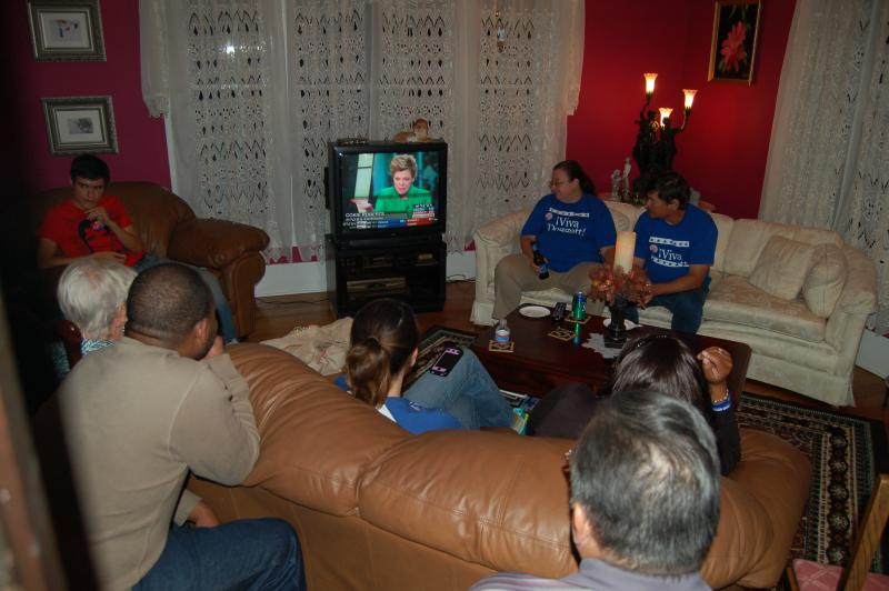 Supporters of Lloyd Doggett gather at a home in central San Antonio to watch election results roll in