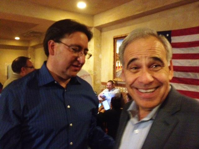 Congressman Charlie Gonzalez (right), who is retiring at the end of this term, shares a moment of elation with the new representative of Congressional District 23