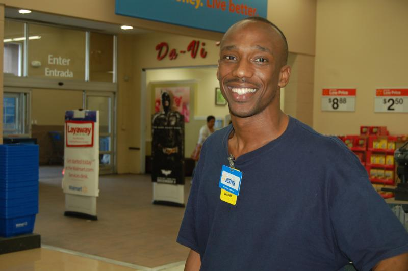 Cashier Joseph Austin makes working during the holidays look easy and fun