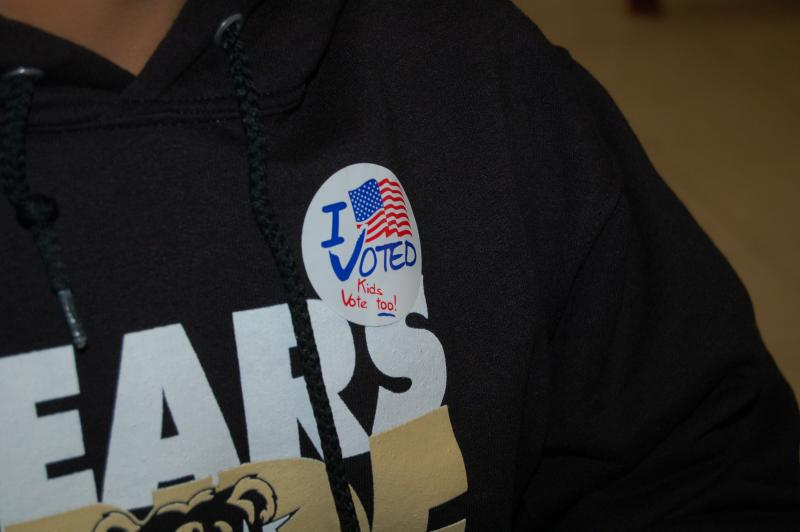 Students receive stickers like adults to signal they participated in the democratic process