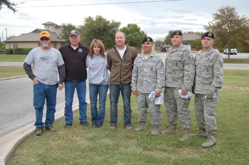Soldiers pose with the Carlsons who collected blankets from JBSA-Lackland
