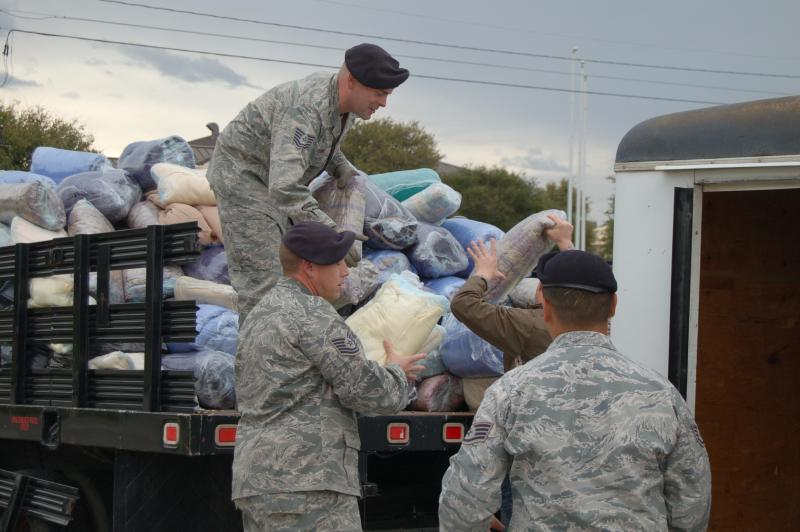 "Sgt. Nicolas Esparza and soldiers from JBSA-Lackland load blankets into trailer for ""Nicci Covers the Cold"" drive"