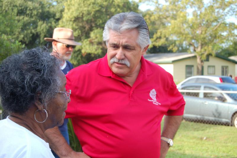Councilman Ray Lopez speaks with residents during a recent work day by Rebuilding Together San Antonio