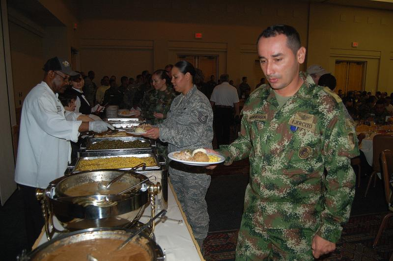 Sgt. Mondragon goes through the line at a Thanksgiving celebration at JBSA-Lackland