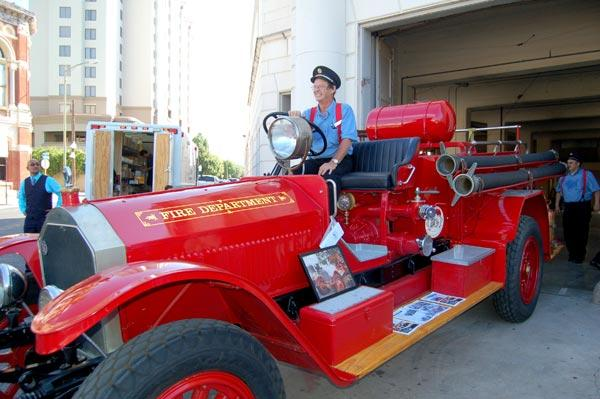 Bob Heckman, project manager for the San Antonio Museum Society museum, sits atop a 1927 American LaFrance pumper truck. Heckman is anxious to open the museum, which will feature an education center for children