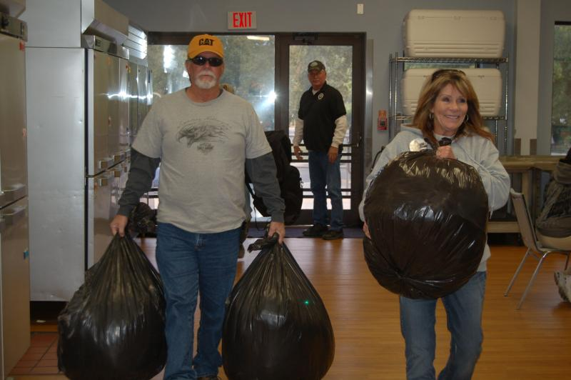 Maurice Johnson (left), Sandi Carlson and husband Owen carry in blanket donations to San Antonio's Christian Senior Services