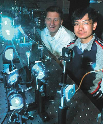 Dr. Herman Batelaan and Hao Gong with their equipment