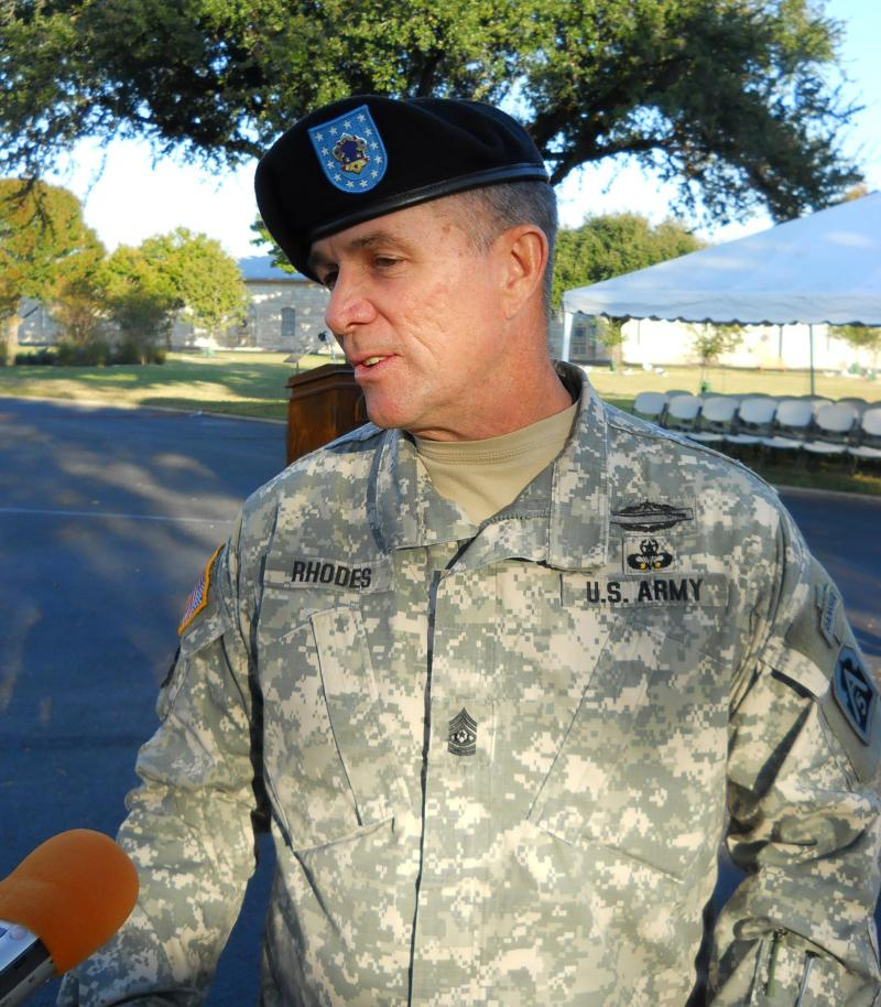 Sgt. Major Hu Rhodes talks to reporters at the U.S. Army North Change of Responsibility ceremony.