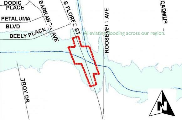 Area marked off for Sixmile Creek drainage improvements for the S. Flores bridge..