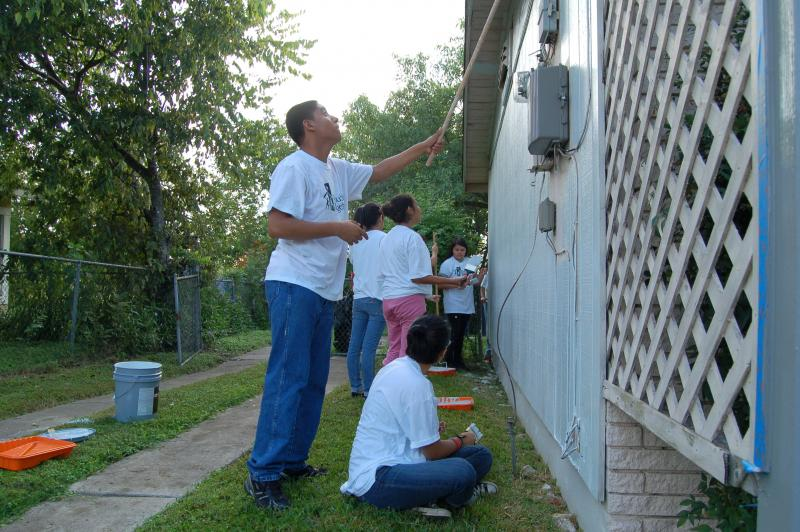 Volunteers paint a home during work day for Rebuilding Together San Antonio. It's one way people are coming together to reinvigorate the west side of town.