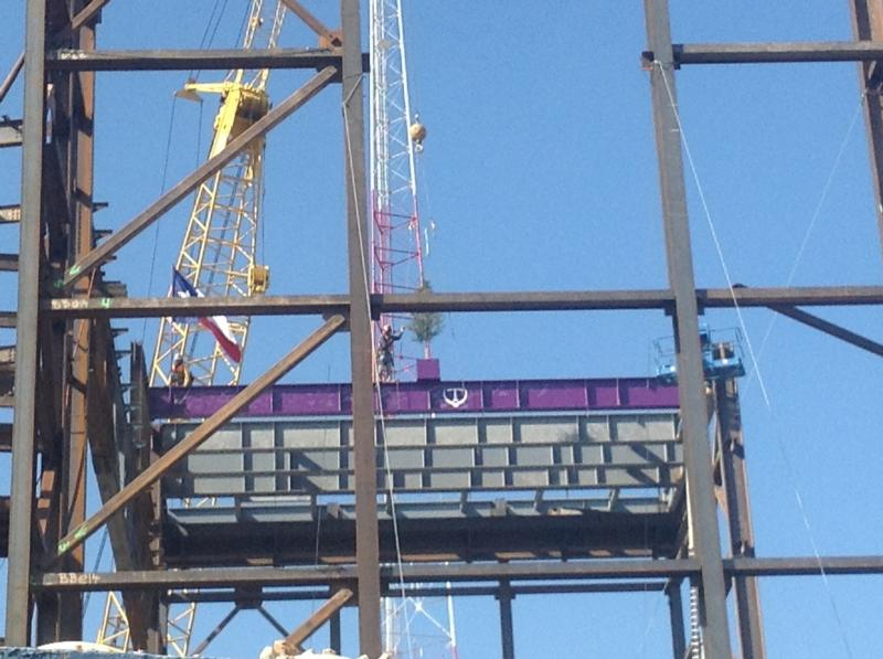 The 5-ton steel beam rests at atop the Tobin Center