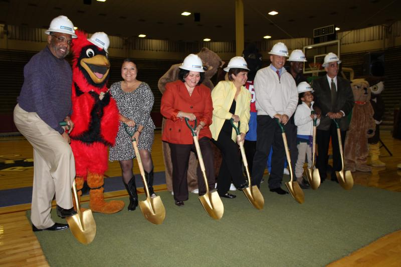 SAISD Trustees and the district's Mascots 'break ground' inside of the Convocation Center. The turf is a piece of Alamo Stadium.
