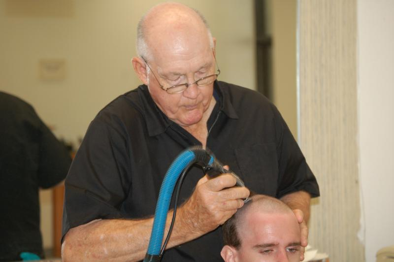 Lester J. West cuts hair of trainees as he has for 51 years at the base barbershop at Joint Base San Antonio-Lackland
