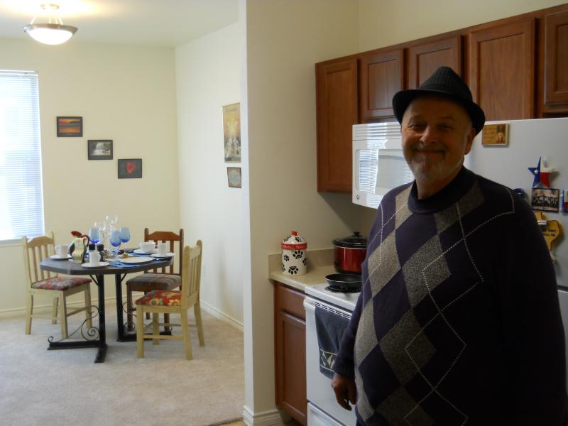 Beaux Gilliam poses in his kitchen. Gilliam is the first to move into the Terraces at Haven for Hope.