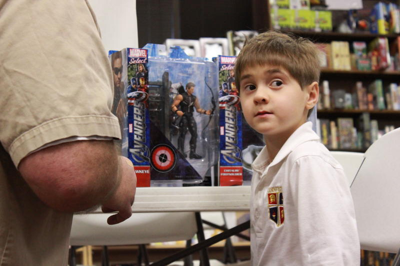 Six-year-old Daniel Adair is a little overwhelmed by all Avengers action figures stacked in front of him.