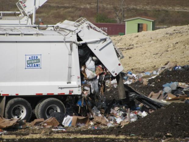 New Braunfels trash trucks unloading at Mesquite Creek Landfill.