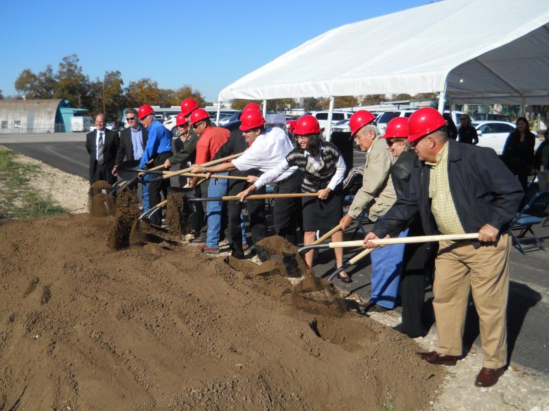 District 3 City Councilwoman Leticia Ozuma (4th from right) breaks ground with other officials.