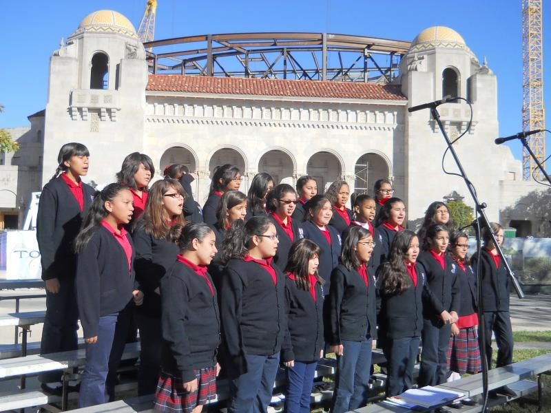 Students from the SAISD's Young Women Leadership Academy sing in front of the Tobin Center for the Performing Arts before the mural unveiling.