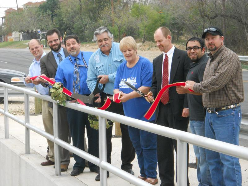 District 6 City Councilman Ray Lopez (center) is joined by Westwood Neighborhood Assn. President Bonnie Weed and CIMS Dir. Mike Frisbe in the ribbon cutting for the road.