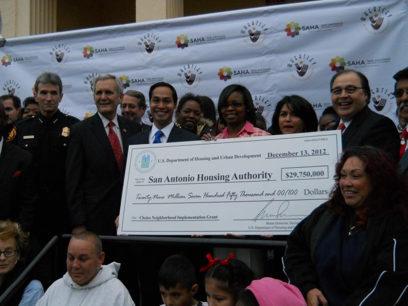 SAPD Chief William McManus (Left), Congressman Lloyd Doggett, San Antonio Mayor Julian Castro, Dist. 2 Councilwoman Ivy Taylor, SAHA President/CEO Lourdes Castro-Ramirez, and SAHA Board Chair Ramiro Cavasos hold the 'mega-check' presented.