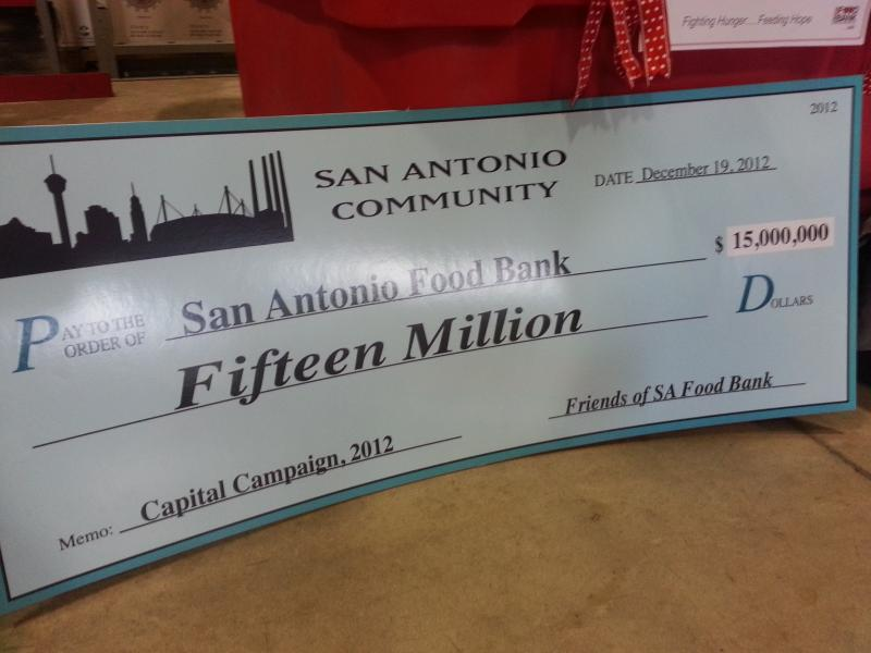 Check for $15 million presented to San Antonio Food Bank president Eric Cooper