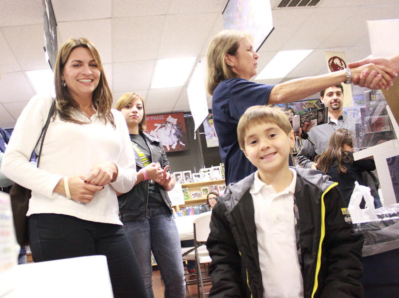 Daniel takes a moment to smile for the camera, with his mom Mary. Aimee Fite from The Wish Connection shakes hands with Assistant Manager Richard Pittman just before they leave.