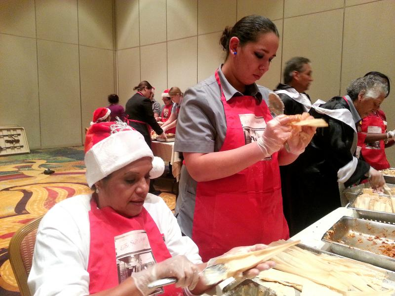 Delia Enriquez, left, and Stephanie Herrera make tamales for the 2012 Tamalathon hosted by Marriott Hotels
