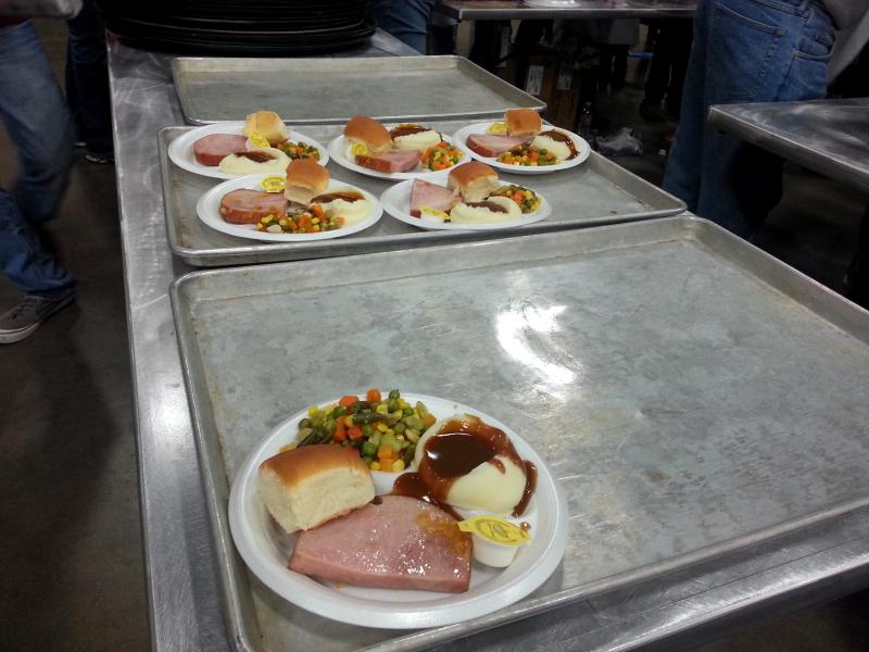 Plates of ham, mashed potatoes, and vegetables were served to thousands of guests